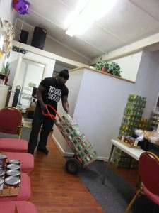 Cameen Volunteering at the Tolles St Mision for Easter food Give outs